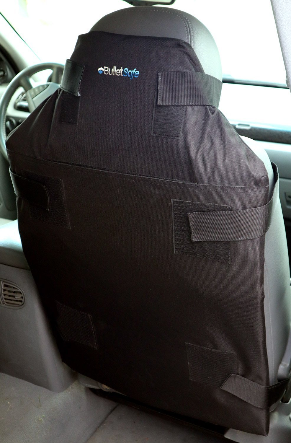 Protecto Panel attached at the back of a car seat